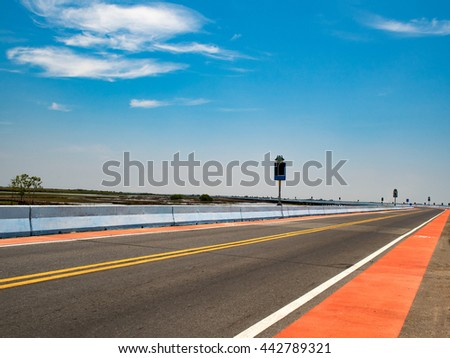 Road. Asphalt road with clouds on blue sky in summer day in South of Thailand. Concept of journey and travel. Concept of goal and target. - stock photo