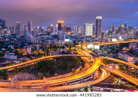 road at night Cityscape in Bangkok city , Thailand.