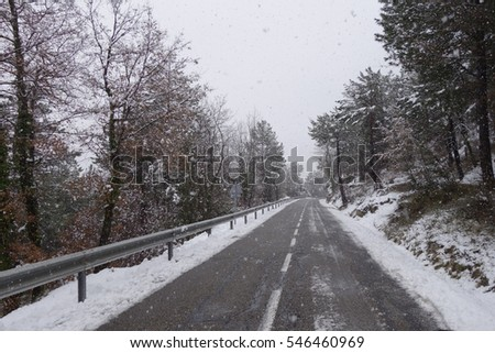 Road at winter, snowing
