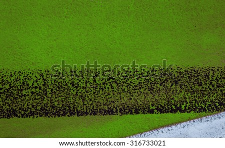 road background with crossing of green white road marking and tire. Line On New Asphalt Road texture background. black asphalt texture. background texture of rough asphalt. Hot fresh asphalt