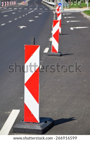 Road barrier arrow traffic signs - stock photo