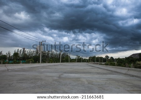 road before thunderstorm - stock photo
