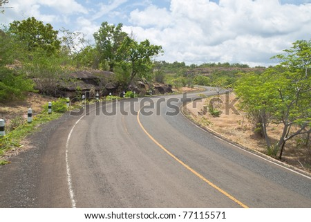 Road beside Mountain and blue sky in Countryside,Pha Taem National Park,North East of Thailand - stock photo