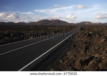 Road between rocks - stock photo