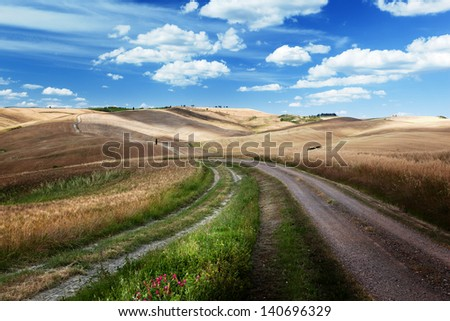 Road between the Fields of Tuscany, Italy - stock photo