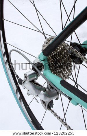Road bike rear wheel with derailleur, chain and gears - stock photo