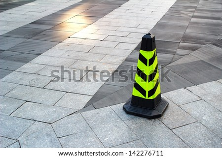 Road block with white arrow - stock photo