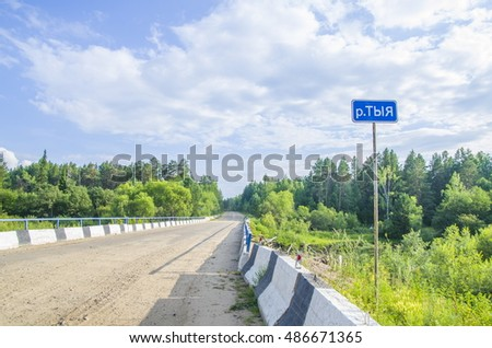 Road bridge over forest river Tyya