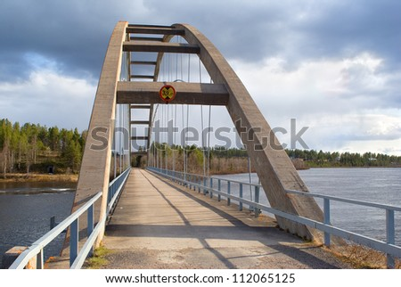 Road bridge over the river in Finland - stock photo