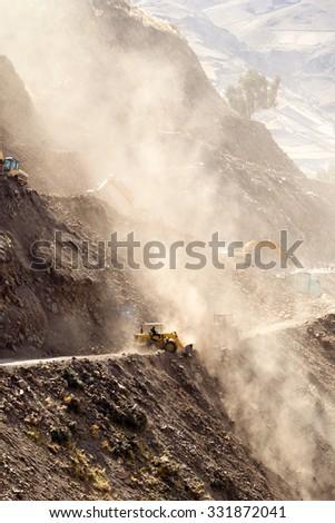 Road Building In Ecuadorian Andes At High Altitude Vertical - stock photo