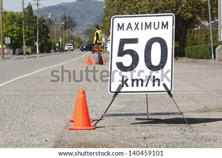 Road check safety as motorists are checked for speeding violations/Road Check Safety/Passing vehicles are reminded of the speed limit. - stock photo