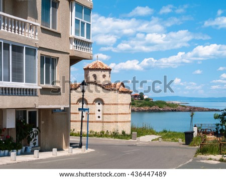 road, church and coastline in Sozopol city - seaside resort on Black Sea coast in Bulgaria - stock photo