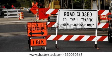 Road Closed Detour Sign - stock photo