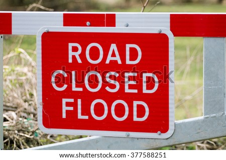 Road Closed Flood Warning Sign on Barrier - stock photo