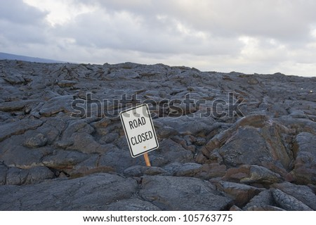 Road closed. Lava has covered the road. - stock photo
