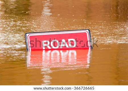 Road closed sign because of flooding due to heavy rain in York, UK - stock photo