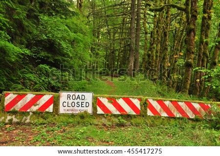 Road closed sign in the forest