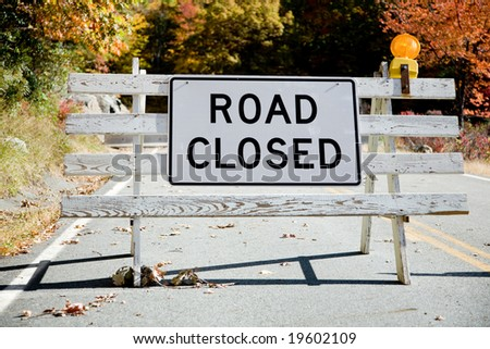 Road Closed sign with concrete barricade