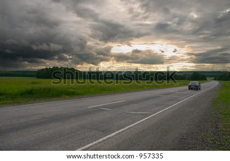 Road, clouds and sunset - stock photo