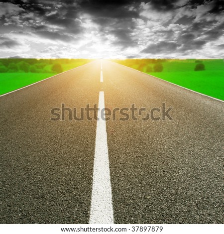 Road,cloudy sky and sun.
