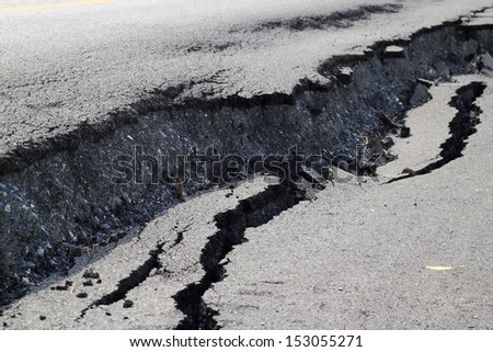 Road collapsed Road subsidence cracking. - stock photo