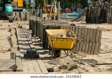 Road construction barrow with blurred background - stock photo