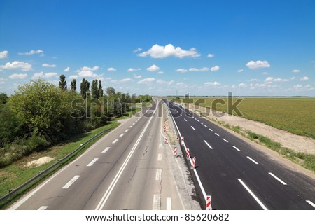 Road construction, new and old highway - stock photo
