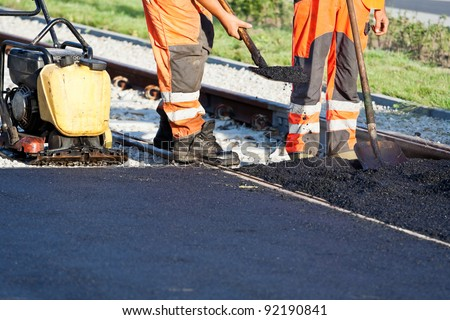 Road construction site, workers and teamwork - stock photo