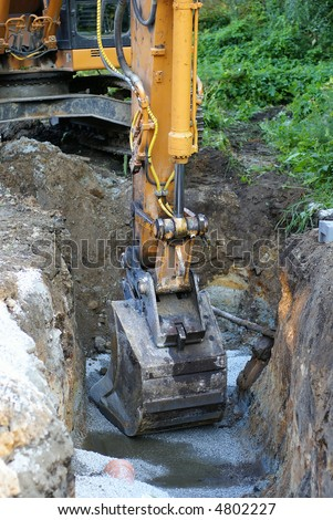 road construction tractor excavator shovel grader - stock photo