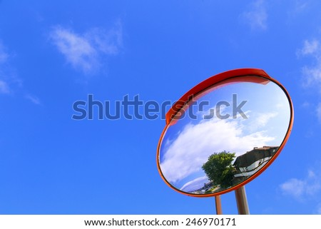 road convex mirror against the sky - stock photo