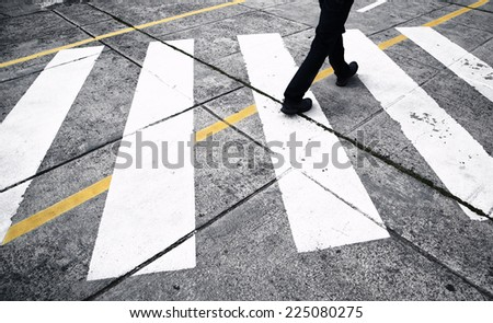 Road crossing with pedestrian feet.  - stock photo