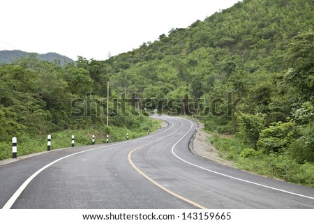 road curve on tropical forest.