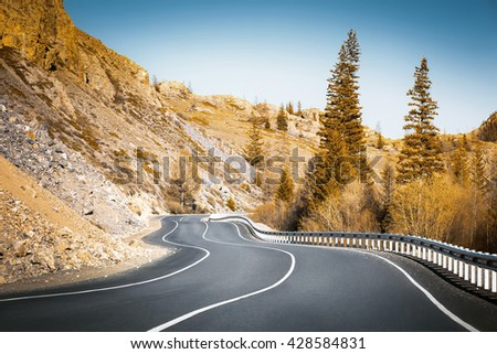 road curves in mountains - stock photo