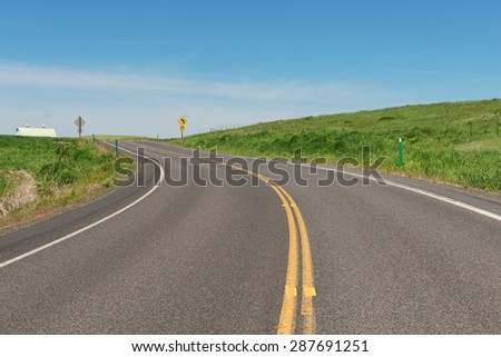 Road curving through rolling hills near Potlatch, Idaho - stock photo