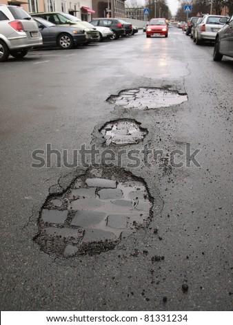 road damage / potholes - stock photo