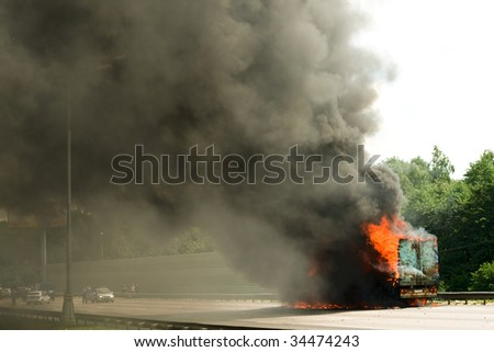 Road disaster - big long truck in fire - stock photo