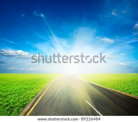 Road, field, sky landscape - stock photo