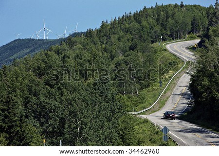 Road, forest and windmill - stock photo