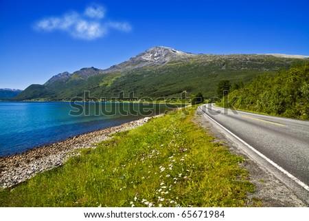 Road going along coast - stock photo