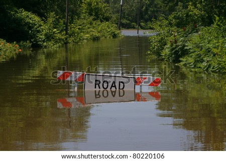 Road going along Hwy 59 to Bean Lake in the 2011 flood in Missouri. - stock photo
