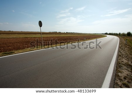 Road going through the countryside - stock photo
