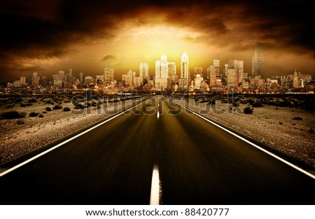 Road heading into city - stock photo