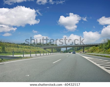 road highway with cars - stock photo