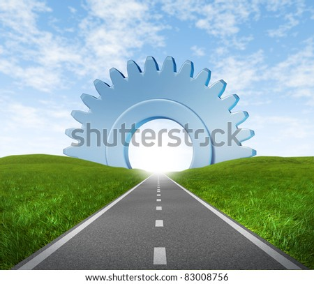 Road highway with green grass and asphalt street with a gear or cog at the horizon representing the concept of journey to a focused destination resulting in success in business. - stock photo