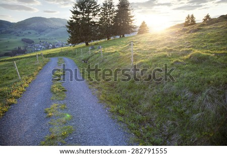 Road in a beautiful landscape at sunset - stock photo