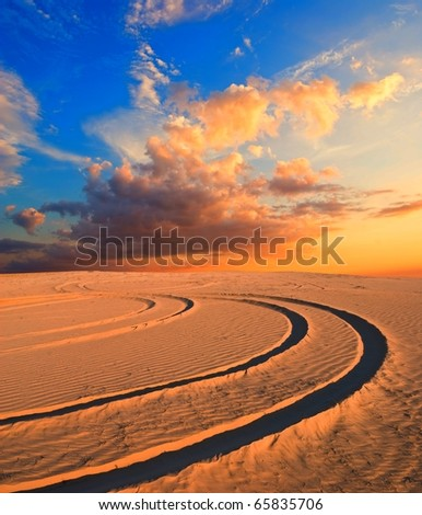 road in a sand desert at the evening - stock photo