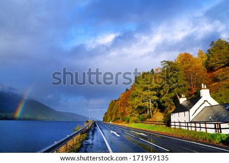 Road in autumn landscape, Highlands, Scotland, United Kingdom - stock photo