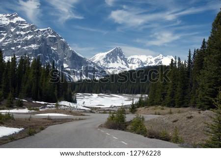 Road in Canadian Rockies, Alberta, Spring - stock photo