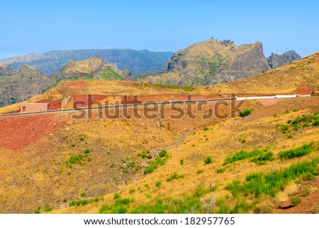 Road in countryside mountain landscape of Madeira island, Portugal - stock photo