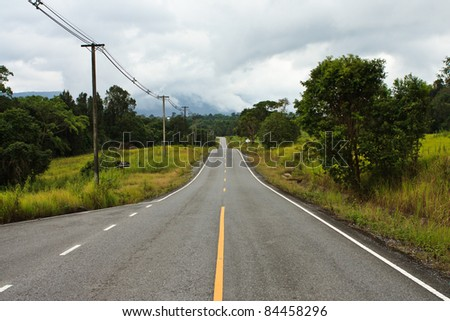 Road in countryside of Thailand - stock photo
